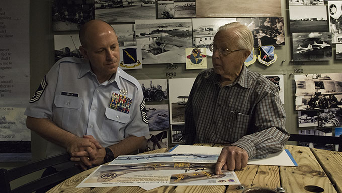 George Prentiss, a Korean War and Air Force veteran, discusses maintenance history with Chief Master Sgt. Christopher Miller, 92nd Maintenance Squadron superintendent, during a base tour at Fairchild Air Force Base, September 29, 2017. Prentiss joined the Air Force in 1952 as a piston jet maintainer and was stationed at Fairchild for four years. (U.S. Air Force photo by Airman 1st Class Jesenia Landaverde)