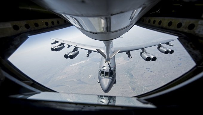 A KC-135 Stratotanker from the 92nd Air Refueling Wing at Fairchild Air Force Base, Wash. refuels B-52 Stratofortress.